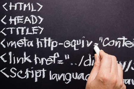metadata: Hand writing computer source code with chalk Stock Photo
