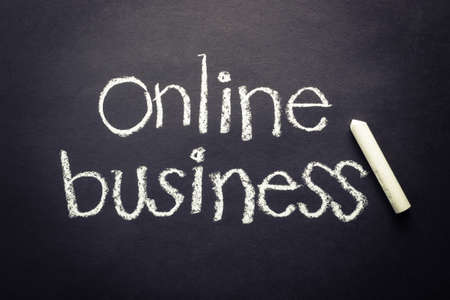 Online business topic, handwriting with chalk photo