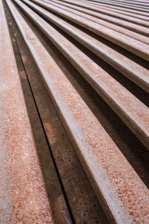 Rusty metal of obsolete railway bar photo