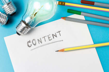 Content writing concept with light bulb as creative symbol photo