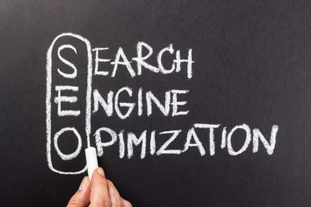 topic: Hand writing Search Engine Optimization (SEO) topic with chalk