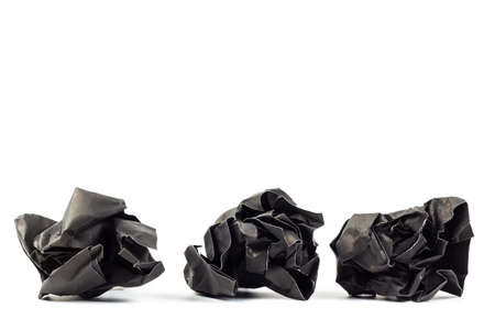 ball lump: Crumpled black paper ball isolated on white background