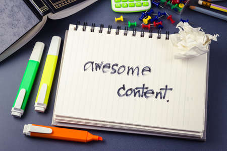 Handwriting of Awesome Content word in notebook for website content concept