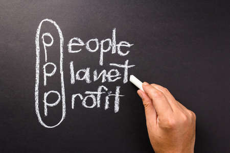 3p marketing of sustainable business with hand pointing at Planet word with chalk photo