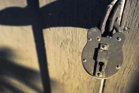 Aged and rusty lock on wood door photo