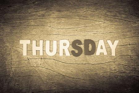 Thursday letters on cracked wood background photo