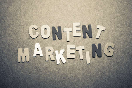 Content marketing word topic in cut wood letter photo