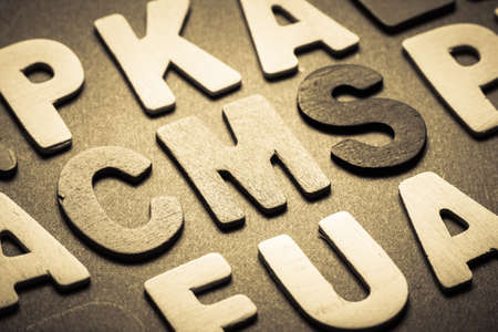 small articles: CMS (content management system) topic in cut wood letter Stock Photo
