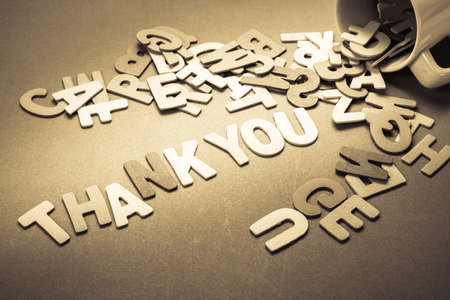 Wood letters spill out of the cup as Thank you word photo