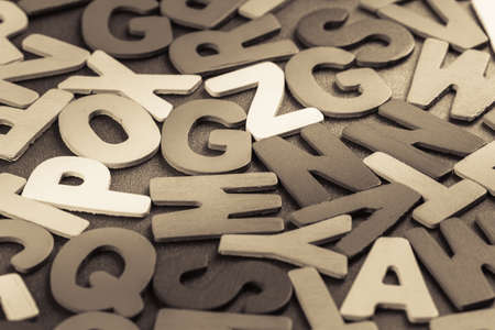 jumble: Scattered wood letters on the table