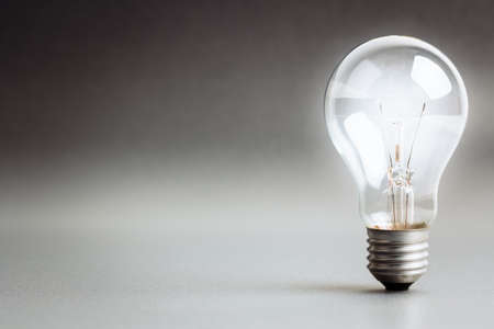 Light bulb glowing white light Stock Photo
