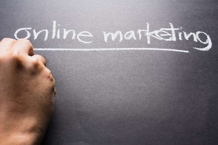 topic: Hand writing Online Marketing topic with chalk
