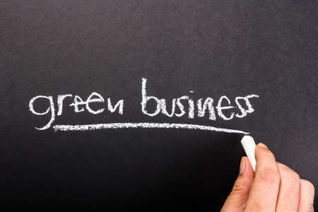 topic: Hand writing Green Business topic on chalkboard Stock Photo
