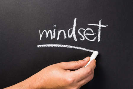 topic: Hand writing Mindset topic with chalk Stock Photo