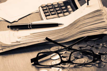 accountancy: Receipts in paper nail on accountant desk