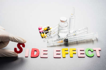 side effect: Hand with Side Effect word and medical equipment Stock Photo