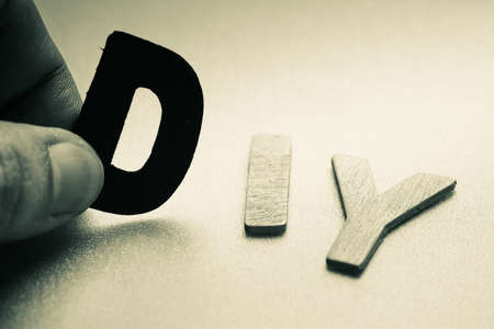 do it yourself: Do it yourself (DIY) in wood letters Stock Photo