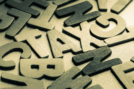 small articles: Tax word in scattered wood letters