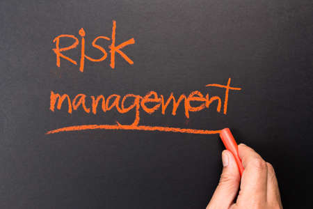topic: Hand underline Risk Management topic on chalkboard