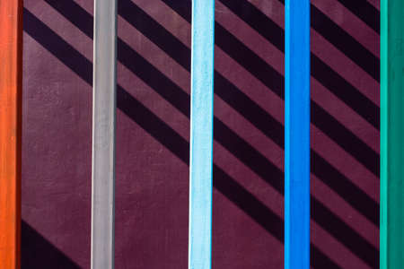 metal post: Abstract building, color metal post on concrete wall with shadow lines Stock Photo