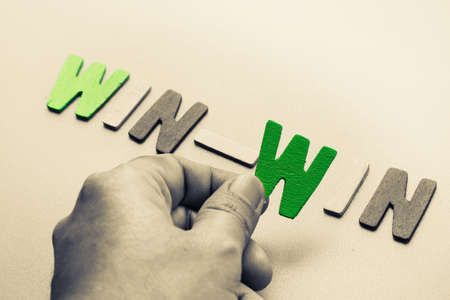 win: Hand arrange wood letters as Win-Win phrase for business concept