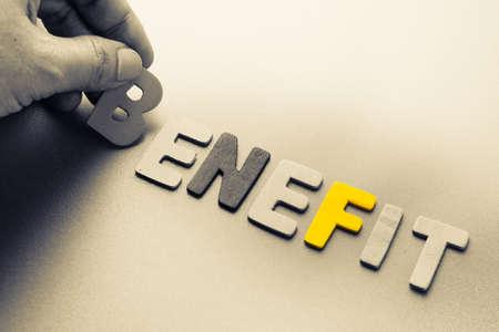 arrange: Hand arrange wood letters as Benefit word Stock Photo