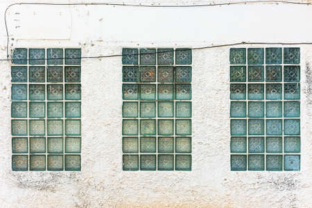 glass block: Glass block on the old concrete wall