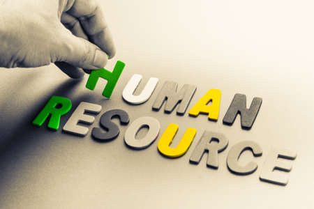 human resource: Hand arrange small wood letters as Human Resource topic Stock Photo