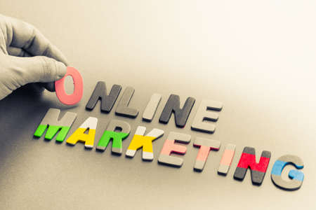 topic: Hand arrange small wood letters as Online Marketing topic
