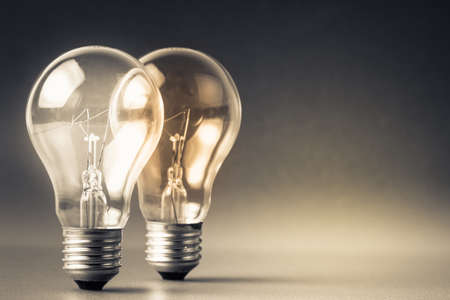 creativity and innovation: Two glowing light bulbs Stock Photo