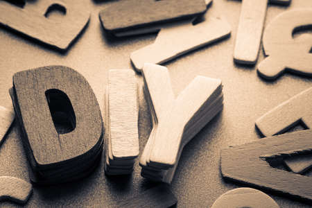 do it yourself: Stack wood letters as Do it yourself (DIY)word