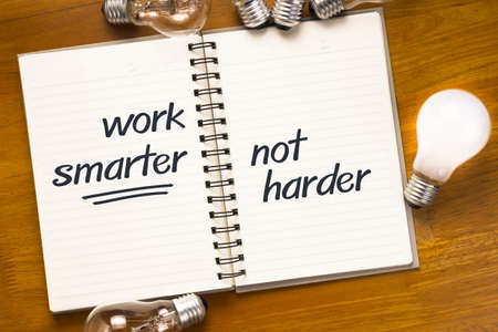 Work Smart Not Hard quote on notebook photo