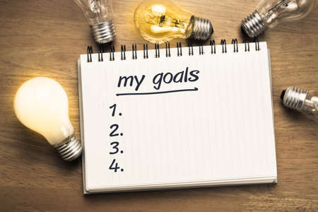 My Goals as memo on notebook with many light bulbs Stock Photo