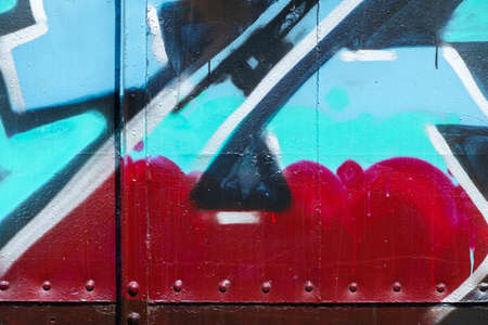 bogie: Color spray as messy graffiti on metal, part of bogie
