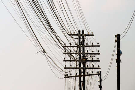wire mess: Electricity pole with many messy wires Stock Photo