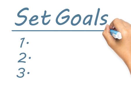 underline: Hand underline Set Goals word  with blank lists on whiteboard