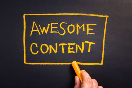 Hand writing  Awesome Content topic with chalk Stock Photo
