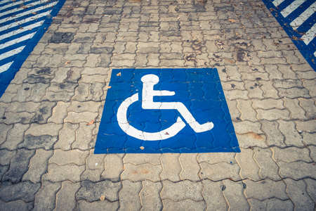 Disabled permit sign on parking lot photo