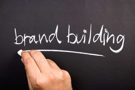 topic: Hand writing Brand Building topic on chalkboard