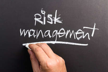 topic: Hand writing Risk Management topic on chalkboard
