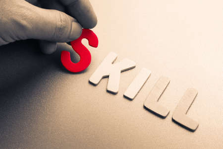 small articles: Hand arrange wood letters as Skill word