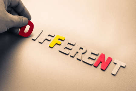 differentiation: Hand arrange wood letters as Different word