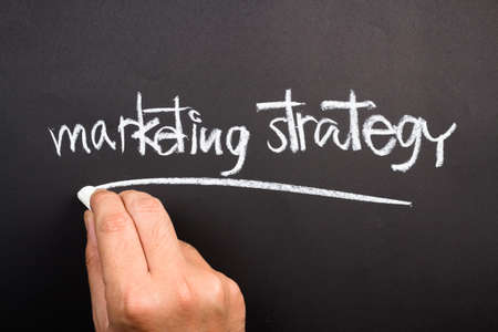 topic: Hand writing Marketing strategy topic on chalkboard
