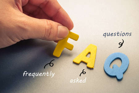 faq: Hand arrange wood letters as FAQ abbreviation ( frequently asked questions )