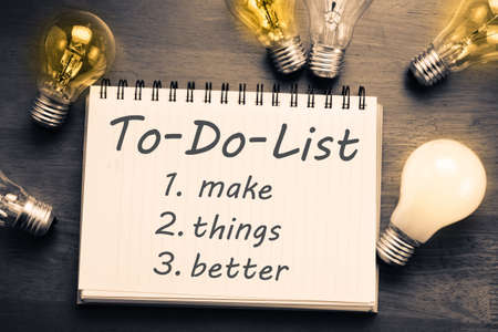 to do list: To Do List memo in notebook with light bulbs