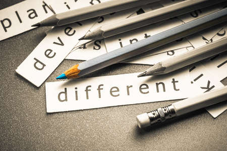 specialize: Closeup piece of paper pile with color pencil, Different concept