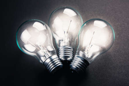 brighter: Three light bulbs glowing brighter than one, teamwork, partnership, win-win concept