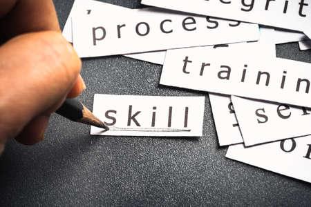 underline: Hand underline on Skill word in piece of paper