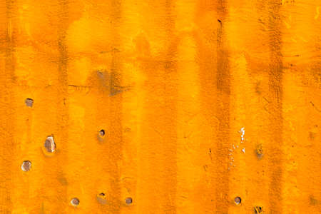 orange texture: Grunge background, sponge material on the wall of old freight container
