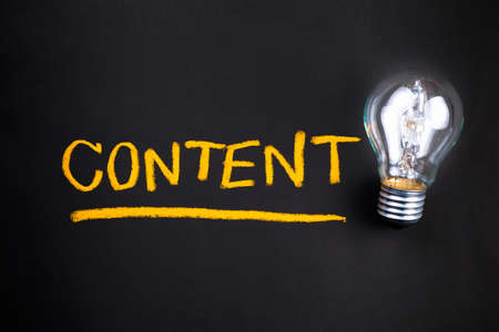 content: Content topic with glowing light bulb Stock Photo